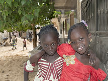 Editorial caption: M�BAO, SENEGAL, AFRICA � AUGUST 6, 2014- Two friends in the street on a feast day Stock Photos
