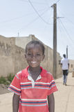 Editorial caption: THIAROYE, SENEGAL, AFRICA – JULY 30, 2014 – Unidentified boy standing in the street Stock Images