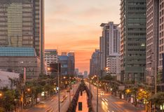 Editorial: Chong Nonsi BTS Station, 15th April 2017. The light o. F car on the road with traffic jam under sunrise in Bangkok Thailand Royalty Free Stock Photos