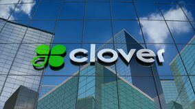 Editorial, Clover Network Inc. logo on glass building.