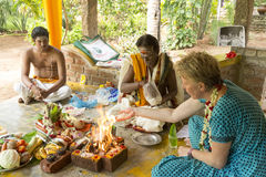 Editorial documentary image. Puja Thila Homa in India. Documentary image. Pondichery, Tamil Nadu, India. May 27, 2014. Puja Thila homa with french lady and Stock Image