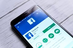Editorial facebook. Kuala Lumpur,Malaysia - January 28th,2018 : Top view of smartphone with Facebook apps on android Play Store.Facebook is an American online Stock Images