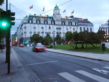 Editorial Grand Hotel Oslo Norway. OSLO, NORWAY-SEPT. 12: The historic Grand Hotel is seen with Norwegian national flags blowing in wind in Oslo, Norway on Stock Photos