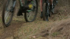EDITORIAL. Group Of Cyclists Moving Fast On Hills stock footage