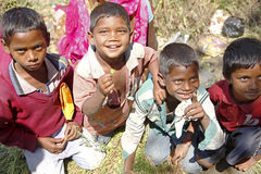 Editorial:Group of Indian boys smile. Group of Indian boys smile in a market in India on March 19, 2015 in Gaya, India Royalty Free Stock Images