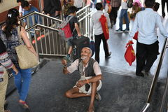 Editorial: Gurgaon, Delhi, India: 06th June 2015: An unidentified old poor man begging from people at Gurgaon,Delhi M.G Road Metro. Editorial: Gurgaon, Delhi royalty free stock photos