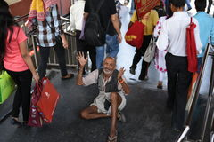 Editorial: Gurgaon, Delhi, India: 06th June 2015: An unidentified old poor man begging from people at Gurgaon,Delhi M.G Road Metro Stock Images