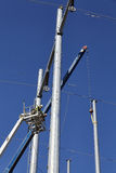 Editorial High voltage power line tower crane workers men Royalty Free Stock Photography