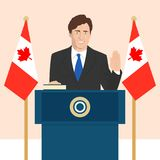 Political leaders topic. 02.12.2017 Editorial illustration of the Canadian Prime Minister Justin Trudeau that is taking an oath on Canadian flag background Royalty Free Stock Photos