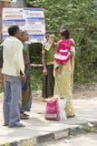 Editorial illustrative image. Family meeting in India. Illustrative image. Pondichery, Tamil Nadu, India. June 15, 2014. Family meeting in the street in park Stock Photography