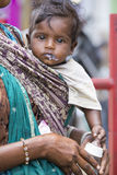 Editorial illustrative image. Mother with baby, India Stock Images