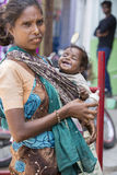 Editorial illustrative image. Mother with baby, India Royalty Free Stock Photography