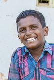 Editorial illustrative image. Poor kid smiling, India Royalty Free Stock Images