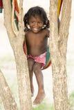 Editorial illustrative image. Poor kid smiling, India Royalty Free Stock Photos