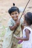 Editorial illustrative image. Poor kid smiling, India Stock Photo