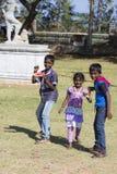 Editorial illustrative image. Poor kid smiling, India Royalty Free Stock Image