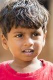 Editorial illustrative image. Poor kid smiling, India Royalty Free Stock Photo