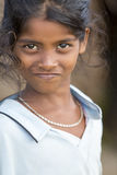 Editorial illustrative image. Poor kid smiling, India Stock Photography