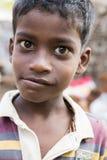 Editorial illustrative image. Poor kid smiling, India Stock Image