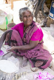 Editorial illustrative image. Poor worker woman in India Stock Images