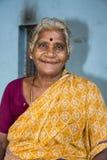 Editorial illustrative image. Portrait of smiling sad senior Indian woman. Stock Photos