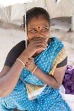 Editorial illustrative image. Portrait of smiling sad senior Indian woman. Royalty Free Stock Photo
