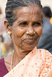 Editorial illustrative image. Portrait of smiling sad senior Indian woman. Stock Images