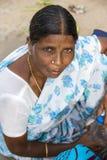 Editorial illustrative image. Portrait of smiling sad senior Indian woman. Royalty Free Stock Images