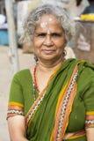 Editorial illustrative image. Portrait of smiling sad senior Indian woman. Stock Photography