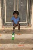 Editorial illustrative image. Sad poor kid, India Royalty Free Stock Image