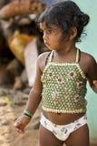 Editorial illustrative image. Sad poor kid, India Stock Photo