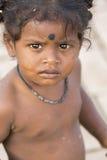 Editorial illustrative image. Sad poor kid, India Royalty Free Stock Images
