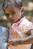 Editorial illustrative image. Sad poor kid, India Stock Photos