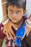 Editorial illustrative image. Sad poor kid, India Royalty Free Stock Photography