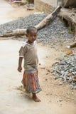 Editorial illustrative image. Sad poor kid, India Stock Images