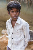 Editorial illustrative image. Sad poor kid, India Stock Photography