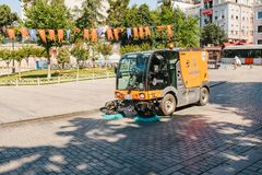 Istanbul, June 16, 2017: Street janitor using cleaning machine to sweep and clean sidewalk tile. Editorial image of street janitor using cleaning machine to Royalty Free Stock Images