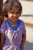 Editorial: Indian child girl smiles. Indian child girl smiles and be shy in a village in India on March 19, 2015 in Gaya, India Stock Photography