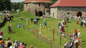 Editorial-Jousting tournament on horseback during the historic medieval festival. PRIOZERSK, RUSSIA- JULY 05, 2015:Jousting tournament on horseback during the stock video footage