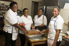 Editorial kitchen staff working Corn Island Nicaragua. Big Corn Island, Nicaragua-April 2: Cooks and kitchen staff are seen making a cake in hotel in Big Corn Stock Photo
