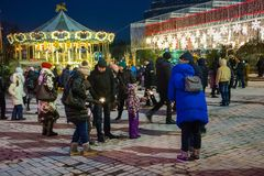 Editorial. Kyiv/Ukraine - January, 13, 2018: New Year`s Fair on Sophia Square. Children ride on the carousel on Sophia Square in the center of Kiev, Ukraine Royalty Free Stock Images