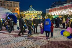 Editorial. Kyiv/Ukraine - January, 13, 2018: New Year`s Fair on Sophia Square. Children ride on the carousel on Sophia Square in the center of Kiev, Ukraine Royalty Free Stock Photos
