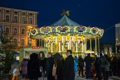 Editorial. Kyiv/Ukraine - January, 13, 2018: New Year`s Fair on Sophia Square. Children ride on the carousel on Sophia Square in the center of Kiev, Ukraine Stock Photography