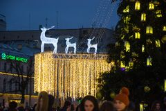 Editorial. Kyiv/Ukraine - January, 13, 2018: New Year`s Fair on Sophia Square. Christmas tree, Glowing reindeer and Christmas decorations on Sophia Square in Royalty Free Stock Images