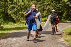 Man walking along a mountain road royalty free stock photos