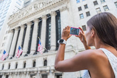 EDITORIAL New York Stock Exchange tourist taking picture. EDITORIAL New York Stock Exchange. Woman tourist on NYC travel vacation taking mobile phone picture of royalty free stock photos
