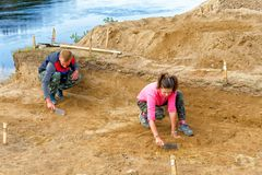 Archaeologists do a sweep of the treated soil during excavation. Editorial.Nyaksimvol village Beryozovsky district of the Khanty-Mansiysk Autonomous Okrug royalty free stock photo