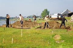 A group of scientists is conducting archaeological excavations in siberian village. Beginning of works. Editorial.Nyaksimvol village Beryozovsky district of the Royalty Free Stock Photo