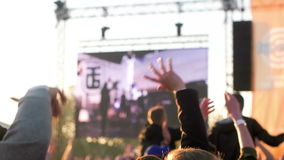 Editorial - People Cheering at Rock Festival. PRAGUE, CZECH REPUBLIC - APR 29, 2016: Large crowd of people gesturing in the rhytm of music stock video footage