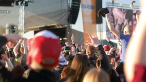 Editorial - People Cheering to Music. PRAGUE, CZECH REPUBLIC - APR 29, 2016: People cheering and dancing to music at open air music festival stock video footage